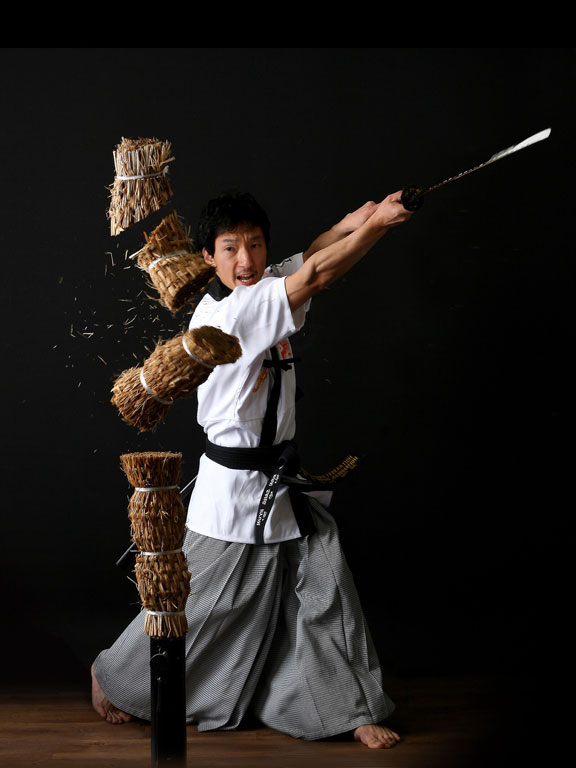 Photo of a Master demonstrating the speed, power, balance of the Body